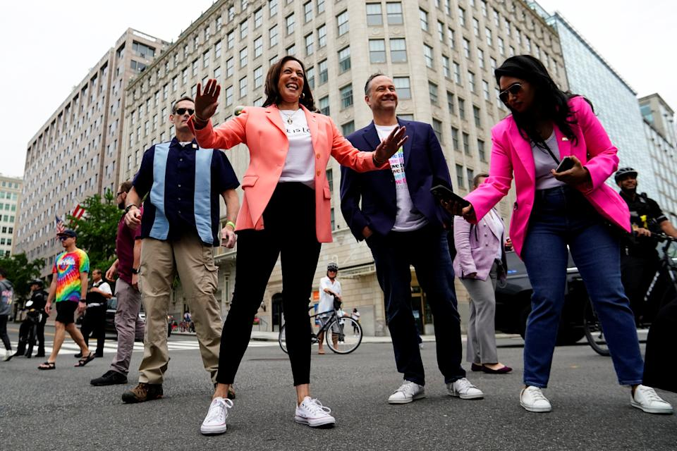 Vice President Kamala Harris gestures next to her husband Doug Emhoff as they attend the Capital Pride Walk and Rally in Washington, D.C. (Erin Scott/Reuters)