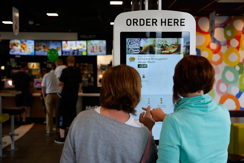 Women order from McDonald's touch screen self-service, coronavirus fears sparked by skin contact