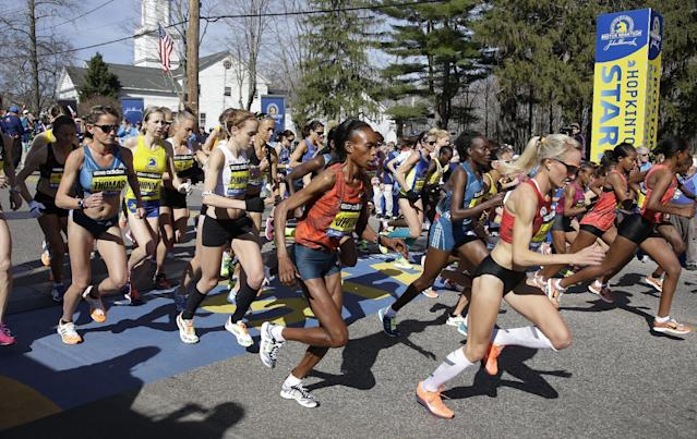 Elite women runners leave the start line of the 118th Boston Marathon Monday, April 21, 2014 in Hopkinton, Mass. (AP Photo/Stephan Savoia)