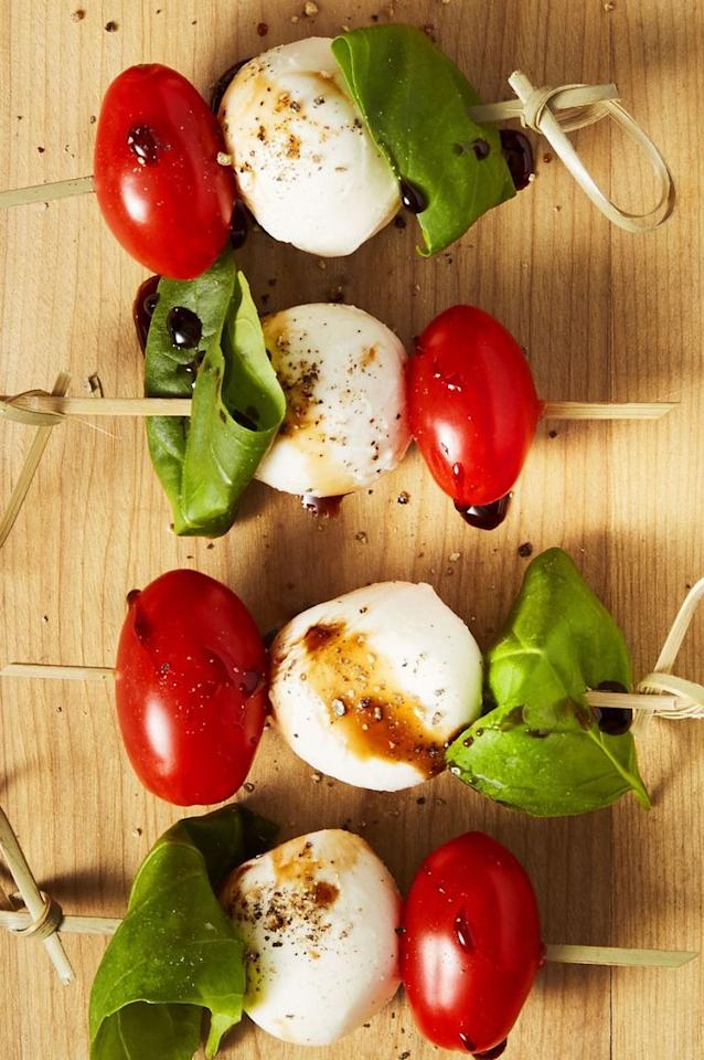 """<p>This skewered, poppable version of your favorite simple salad makes it the ideal easy appetizer to enjoy sans fork, knife or seat. </p><p><em><a href=""""https://www.goodhousekeeping.com/food-recipes/easy/a44232/caprese-bites-recipe/"""" target=""""_blank"""">Get the recipe for Caprese Bites »</a></em></p><p><strong>RELATED:</strong> <a href=""""https://www.goodhousekeeping.com/food-recipes/healthy/g845/healthy-appetizers/"""">28 So-Easy Appetizers That Are Healthy and Delicious</a></p>"""