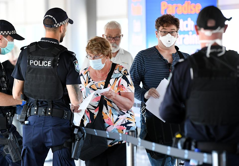 Picture of police screening incoming passengers at the domestic airport in Brisbane, Queensland is one of the Australian states which has closed its borders, limiting interstate travel amid the COVID-19 outbreak