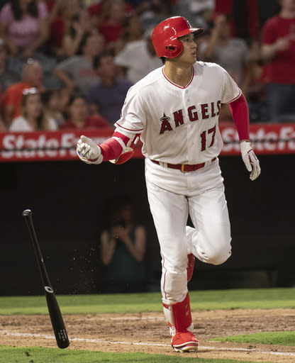 Los Angeles Angels' Shohei Ohtani watches his solo home run during the fourth inning of a baseball game against the Chicago White Sox in Anaheim, Calif., Monday, July 23, 2018. (AP Photo/Kyusung Gong)
