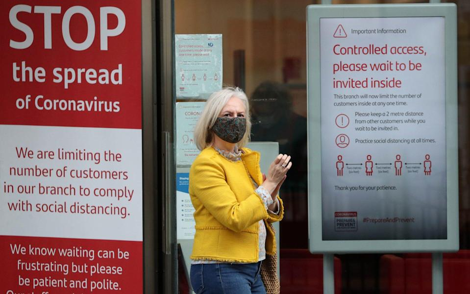 Woman and coronavirus signs - Andrew Milligan/PA