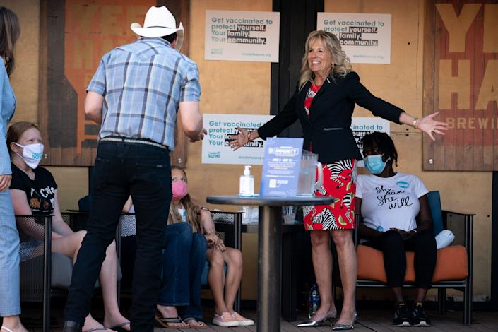 First lady Jill Biden joins country music star Brad Paisley to tour a pop-up vaccine clinic at Ole Smoky Distillery in Nashville, Tenn., Tuesday, June 22, 2021. Biden visited the clinic as part of the #WeCanDoThis bus tour.