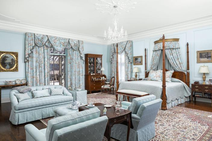 <p>The master suite spotlights a crystal chandelier, custom built-in cabinetry, extensive crown moldings, and more thoughtful details.</p>