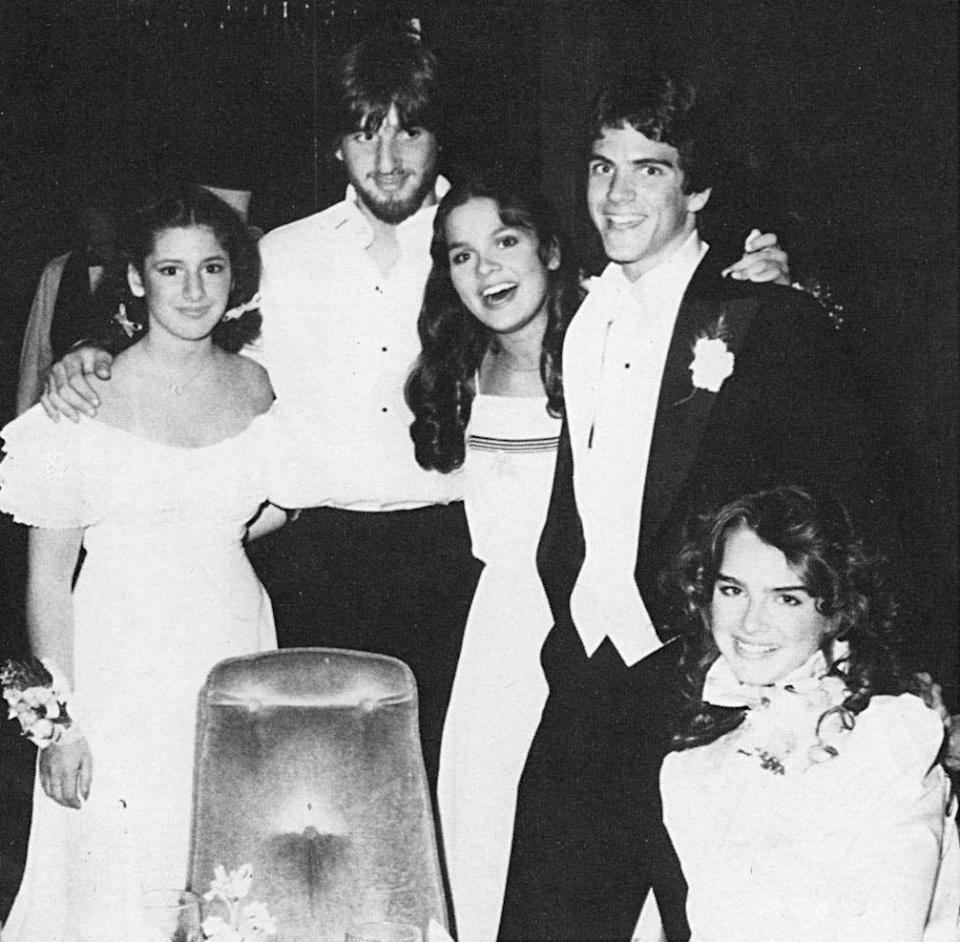 """<p>Teenage Brooke Shields took a night off from her work as an actress and model for the 1982 prom at Englewood, N.J.'s Dwight Englewood High School, but the night was still very Hollywood. """"My date was Ted McGinley, if you can believe it, from <i>Love Boat</i>,"""" she told the <a href=""""http://nypost.com/2010/04/25/brooke-shields-the-way-i-wore/"""" rel=""""nofollow noopener"""" target=""""_blank"""" data-ylk=""""slk:New York Post"""" class=""""link rapid-noclick-resp"""">New York Post</a> in 2010. """"We were dating at the time, and he said he would fly in from California to be my date."""" Not to mention that Shields's dress was one from her latest film, <i>Sahara</i>, designed by none other than Valentino. <i>(Photo: Seth Poppel/Yearbook Library)</i></p>"""
