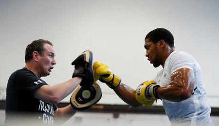 Boxing - Anthony Joshua Media Session - Sheffield, Britain - March 21, 2018 Anthony Joshua and trainer Robert McCracken during the media session Action Images via Reuters/Andrew Couldridge