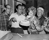 <p>Lucille takes a big bite of cake next to her costar, Bob Hope, on the set of <em>The Facts of Life</em>. That same year, Lucille and Desi filed for divorce. The actress married comedian Gary Morton a year after the divorce was finalized. </p>