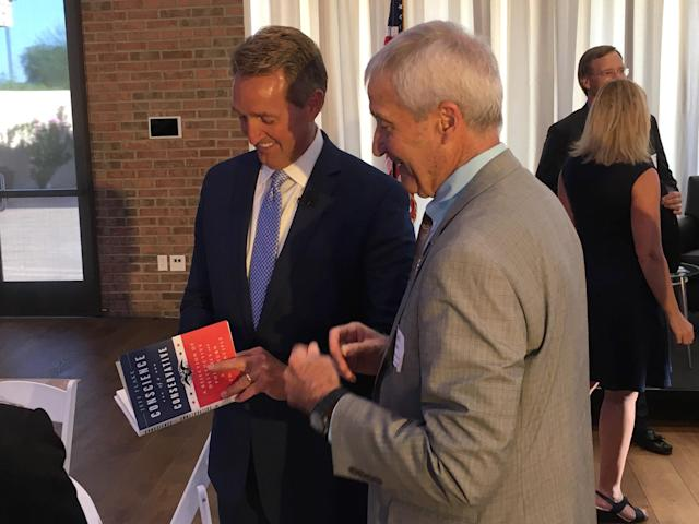 "Sen. Jeff Flake signs a copy of his book, ""Conscience of a Conservative,"" at a Chamber of Commerce breakfast in Gilbert, Ariz. (Photo: Andrew Romano/Yahoo News)"