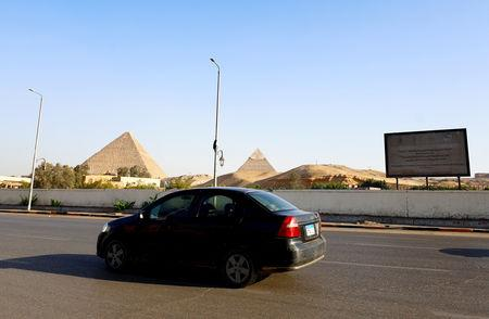 FILE PHOTO: A car drives past pyramids near the site of a blast which damaged a bus near a new museum being built close to the Giza pyramids in Cairo, Egypt, May 19, 2019. REUTERS/Amr Abdallah Dalsh/File Photo