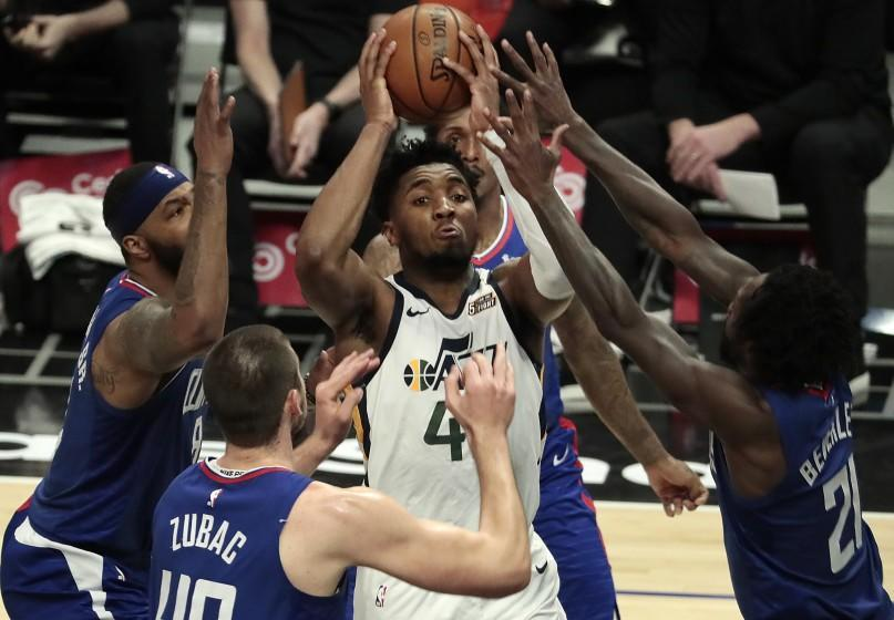 Los Angeles, CA, Wednesday, February 17, 2021 - Utah Jazz guard Donovan Mitchell (45) I surrounded by Clippers defenders in the second half at Staples Center. (Robert Gauthier/Los Angeles Times)