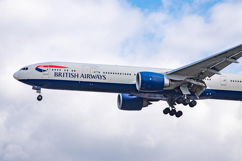 British Airways Boeing 777-300 Extended Range Edition aircraft specifically 777-36N (ER) as seen on final approach landing at London Heathrow International Airport LHR EGLL in England, UK over the houses of Myrtle Avenue on 29 October 2019. The B777 long-haul wide-body airplane has the registration G-STBB and 2x GE jet engines. British Airways BA BAW Speedbird is the flag carrier of the United Kingdom with main base hub Heathrow Airport. The airline has 278 airplanes, is a member of Oneworld aviation alliance and is owned by International Airlines Group IAG. (Photo by Nicolas Economou/NurPhoto via Getty Images)