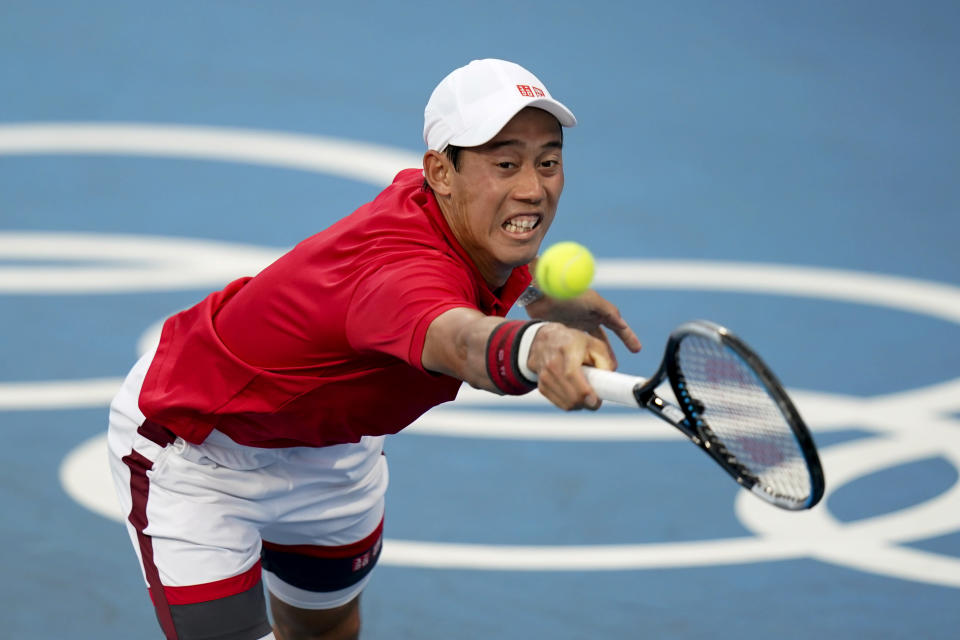 Kei Nishikori, of Japan, returns to Andrey Rublev, of the Russian Olympic Committee, during the tennis competition at the 2020 Summer Olympics, Sunday, July 25, 2021, in Tokyo, Japan. (AP Photo/Patrick Semansky)
