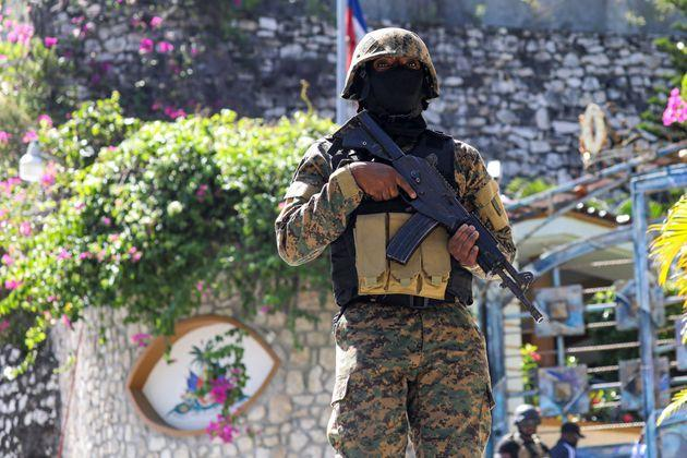 A Haitian police officer stands guard outside of the presidential residence on July 7, 2021 in Port-au-Prince, Haiti. - Haiti President Jovenel Moise was assassinated and his wife wounded early July 7, 2021 in an attack at their home, the interim prime minister announced, an act that risks further destabilizing the Caribbean nation beset by gang violence and political volatility. Claude Joseph said he was now in charge of the country and urged the public to remain calm, while insisting the police and army would ensure the population's safety.The capital Port-au-prince as quiet on Wednesday morning with no extra security forces on patrol, witnesses reported. (Photo by VALERIE BAERISWYL / AFP) (Photo by VALERIE BAERISWYL/AFP via Getty Images) (Photo: VALERIE BAERISWYL via Getty Images)