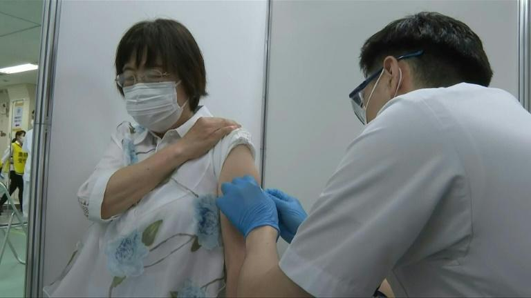 Eldery receive Covid-19 shots as mass vaccination center opens in Tokyo