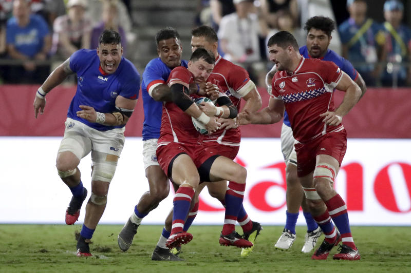 Russia's Vasily Artemyev is tackled by Samoa's Alapati Leiua during the Rugby World Cup Pool A game between Russia and Samoa at Kumagaya Rugby Stadium, Kumagaya City, Japan, Tuesday, Sept. 24, 2019. (AP Photo/Jae Hong)