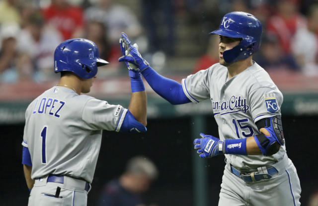 Kansas City Royals' Nicky Lopez, left, congratulates Whit Merrifield after Merrifield hit a solo home in the fourth inning in a baseball game against the Cleveland Indians, Monday, June 24, 2019, in Cleveland. (AP Photo/Tony Dejak)