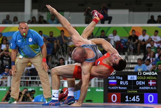 <p>Mark Overgaard Madsen of Denmark competes against Roman Vlasov of Russia during the Men's Greco-Roman 75 kg Gold Medal match on Day 9 of the Rio 2016 Olympic Games at Carioca Arena 2 on August 14, 2016 in Rio de Janeiro, Brazil. (Photo by David Ramos/Getty Images) </p>