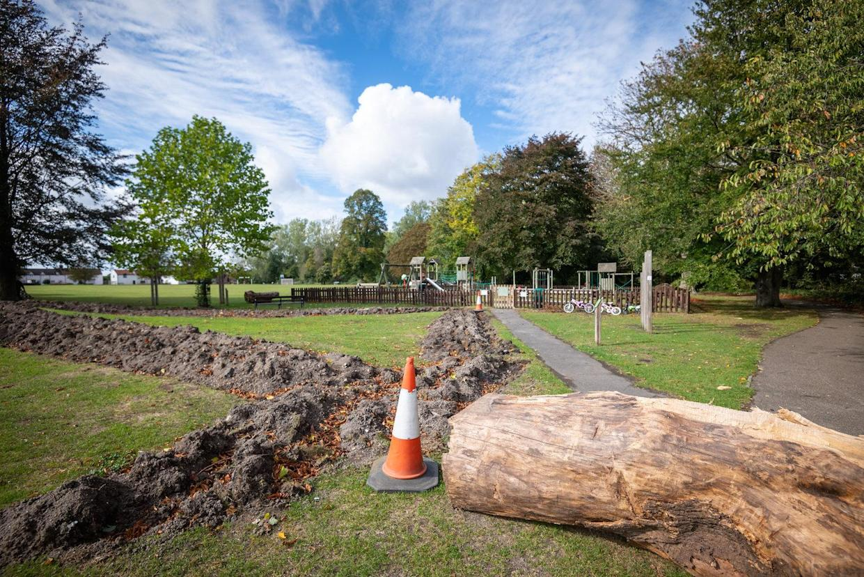 Large tree trunks have been placed to block the route into the playing fields (Picture: SWNS)