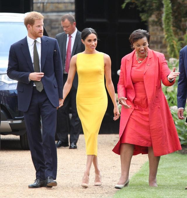 The Duke and Duchess of Sussex, with Baroness Scotland, arrive to attend the Your Commonwealth Youth Challenge reception at Marlborough House in London. Yui Mok/PA Wire