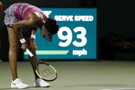 Mar 30, 2017; Miami, FL, USA; Venus Williams of the United States reacts after missing a shot against Johanna Konta of Great Britain (not pictured) in a women's singles semi-final during the 2017 Miami Open at Crandon Park Tennis Center. Konta won 6-4, 7-5. Mandatory Credit: Geoff Burke-USA TODAY Sports