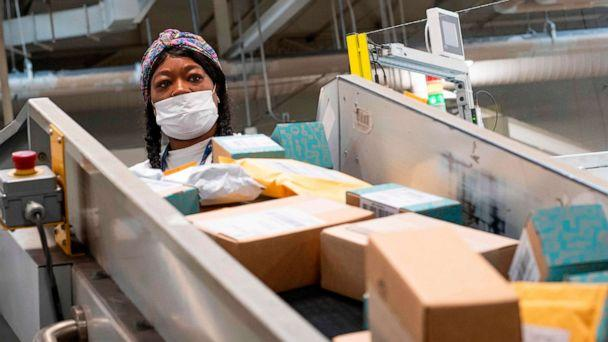 PHOTO: (FILES) In this file photo taken on April 30, 2020, a postal worker sort mail at a Los Angeles, California, facility. (Valerie Macon/AFP via Getty Images)