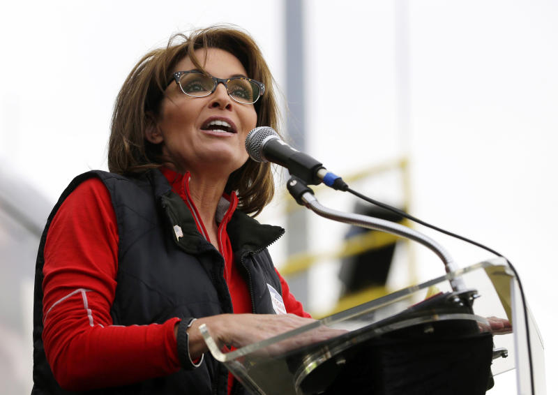 """FILE - This Oct. 12, 2013 file photo shows former Alaska Gov. Sarah Palin during a rally supporting Steve Lonegan who is running for the vacant New Jersey seat in the U.S. Senate, in New Egypt, N.J. The Sportsman Channel said Monday it has hired Sarah Palin to be host of a weekly outdoors-oriented program that will celebrate the """"red, wild and blue"""" lifestyle. The program, """"Amazing America,"""" will debut next April. (AP Photo/Julio Cortez, File)"""