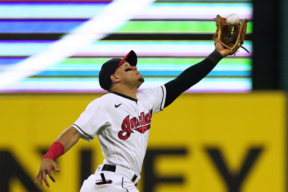Cleveland Indians' Cesar Hernandez catches a fly ball hit by Tampa Bay Rays' Mike Zunino during the sixth inning of a baseball game Saturday, July 24, 2021, in Cleveland. (AP Photo/Tony Dejak)
