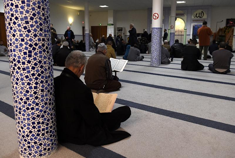 Muslims pray on January 2, 2016 at Valence's mosque, in southeastern France, a day after a driver was shot and wounded as he drove a car at four soldiers guarding the mosque (AFP Photo/Philippe Desmazes)