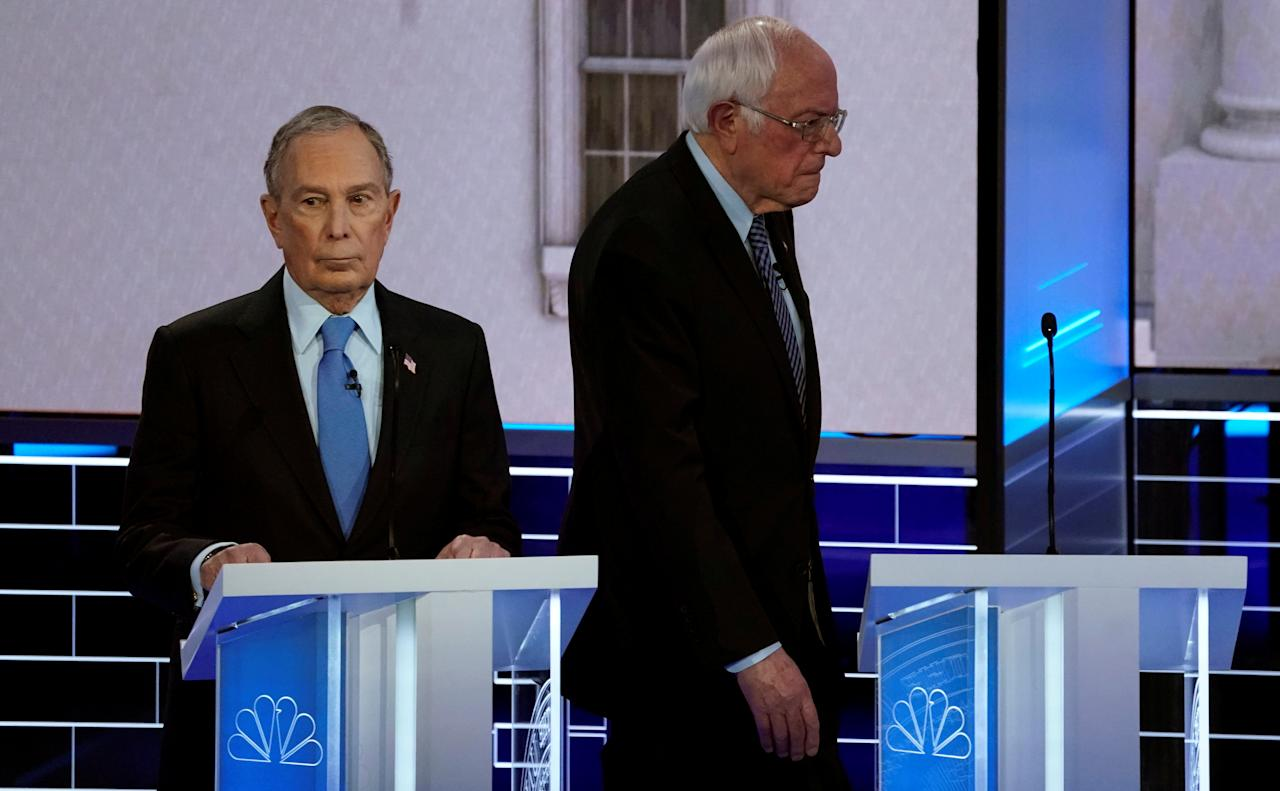 Senator Bernie Sanders walks behind former New York City Mayor Mike Bloomberg during a break at the ninth Democratic 2020 U.S. Presidential candidates debate at the Paris Theater in Las Vegas, Nevada, U.S., February 19, 2020. REUTERS/Mike Blake     TPX IMAGES OF THE DAY