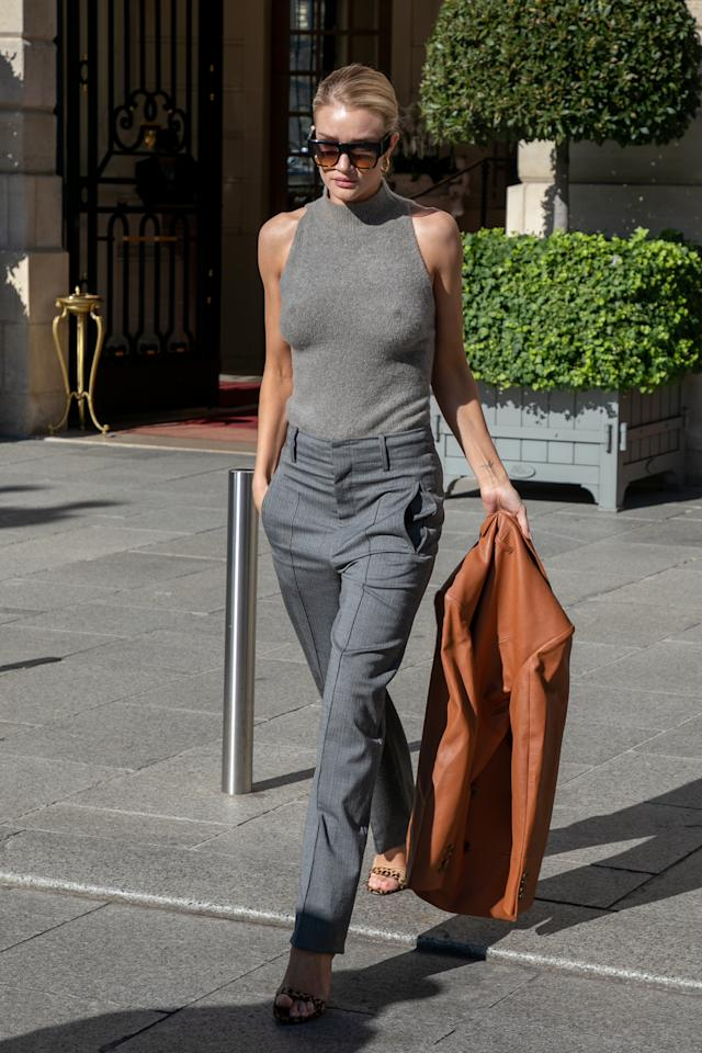 <p>There's something a bit 70s working girl about Rosie Huntington-Whiteley's Paris get up. We love everything from the tailored trousers to the tan leather jacket and oversized sunglasses. <br />[Photo: Getty] </p>