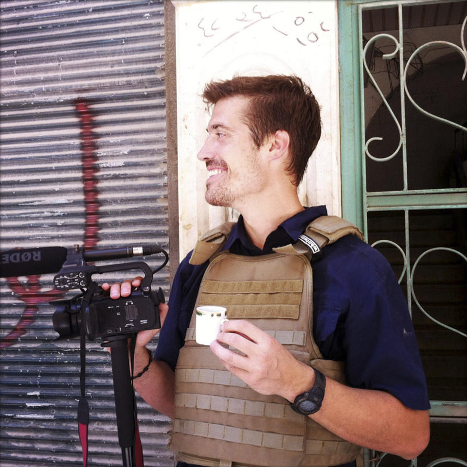 <p>               This photo posted on the website freejamesfoley.org shows journalist James Foley in Aleppo, Syria, in July, 2012. The family of an American journalist says he went missing in Syria more than one month ago while covering the civil war there. A statement released online Wednesday by the family of James Foley said he was kidnapped in northwest Syria by unknown gunmen on Thanksgiving day. (AP Photo/Nicole Tung, freejamesfoley.org) NO SALES