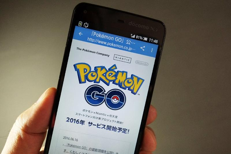 Nintendo cut its full-year outlook despite the immense global popularity of the Pokemon Go app this summer, which was downloaded by millions, as thefranchise-creator does not own the game's licence (AFP Photo/Kazuhiro Nogi)
