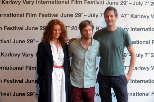 (From L) Norwegian actress Janne Heitberg Haarseth, director Martin Lund and actor Henrik Rafaelsen pose