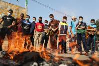 Palestinians gather to protest against the publications of a cartoon of Prophet Mohammad