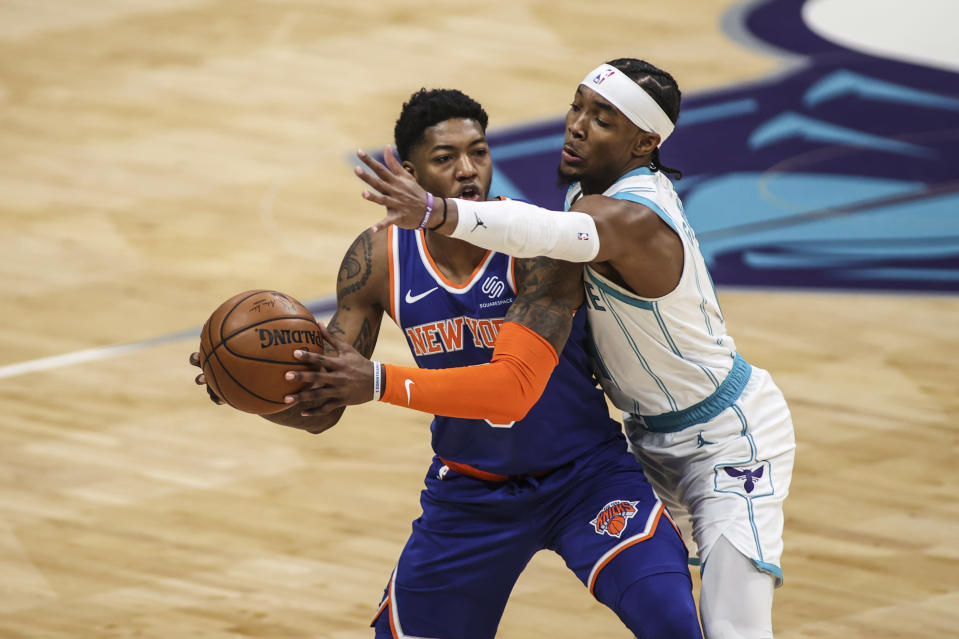 Charlotte Hornets guard Devonte' Graham, right, disrupts New York Knicks guard Elfrid Payton in the first quarter of an NBA basketball game in Charlotte, N.C., Monday, Jan. 11, 2021. (AP Photo/Nell Redmond)