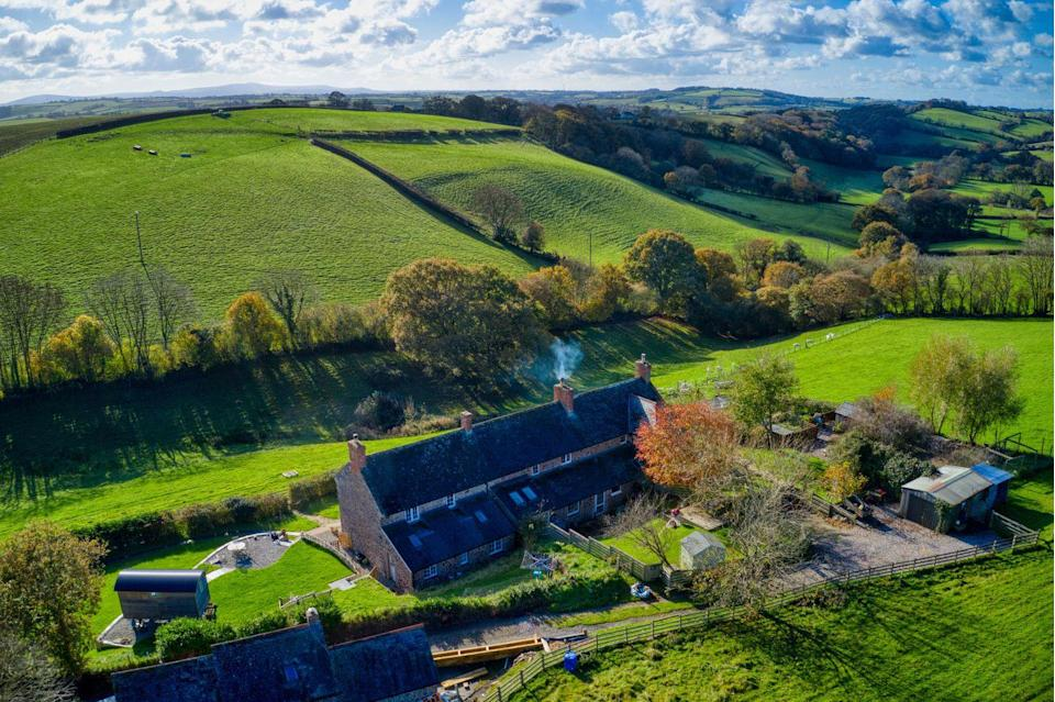 """<p>As pretty as a picture book, Bramble Cottage has three bedrooms, a traditional country kitchen, roaring fireplaces and wraparound countryside views. </p><p><a href=""""https://www.onthemarket.com/details/9584073/v"""" rel=""""nofollow noopener"""" target=""""_blank"""" data-ylk=""""slk:This property is currently on the market for £300,000 with Michael Adey Property at OnTheMarket"""" class=""""link rapid-noclick-resp"""">This property is currently on the market for £300,000 with Michael Adey Property at OnTheMarket</a></p>"""