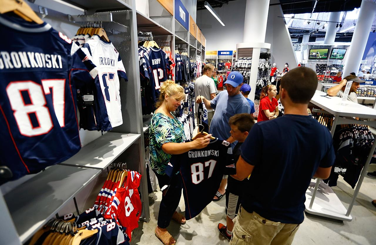 FOXBORO, MA - JULY 7: New England Patriots fans trade in their Aaron Hernandez jerseys during a free exchange at the pro shop at Gillette Stadium on July 7, 2013 in Foxboro, Massachusetts. (Photo by Jared Wickerham/Getty Images)