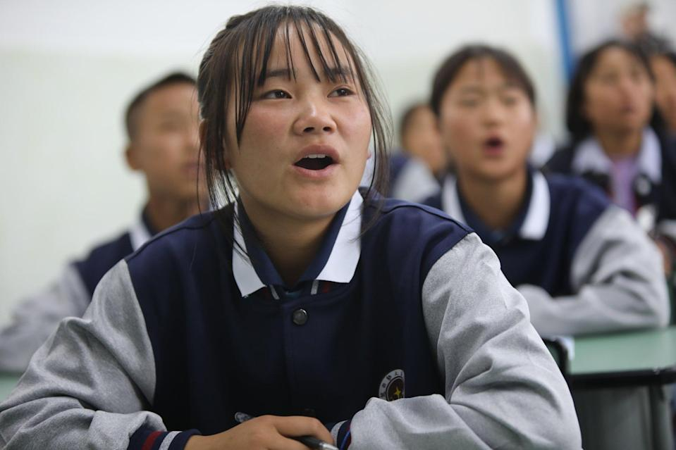 Students study written ethnic Yi language in class at Wenchang Middle School in Yuexi county, Liangshan Yi autonomous prefecture, Sichuan province. More than 120 languages are spoken in China, of which 25 are rated crticially endangered in a new study. Photo: Simon Song
