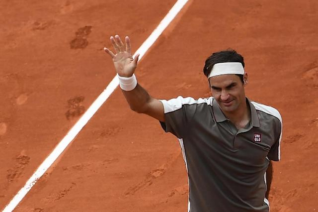 Federer made a winning return to Roland Garros on Sunday (AFP Photo/Anne-Christine POUJOULAT )