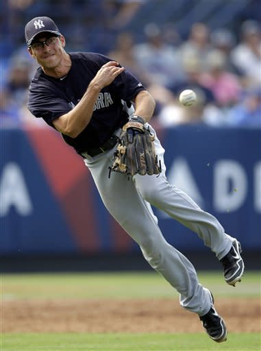 New York Yankees' third baseman Doug Bernier throws to first base for an out in the fifth inning of a spring training baseball game against the New York Mets in Port St. Lucie, Fla., Tuesday, April 3, 2012. (AP Photo/Patrick Semansky)