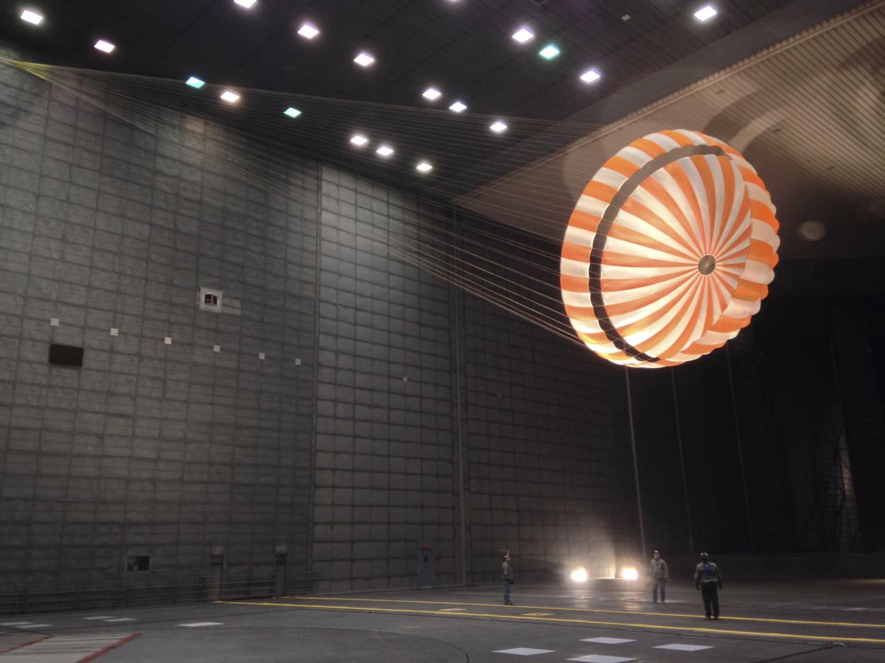 In this February 2015 photo made available by NASA, the parachute for the InSight mission to Mars is tested inside the world's largest wind tunnel at NASA Ames Research Center in Mountain View, Calif. NASA's InSight spacecraft will enter the Martian atmosphere at supersonic speed, then hit the brakes to get to a soft, safe landing on the alien red plains. After micromanaging every step of the way, flight controllers will be powerless over what happens at the end of the road, nearly 100 million miles away.(NASA/JPL-Caltech/Lockheed Martin via AP)