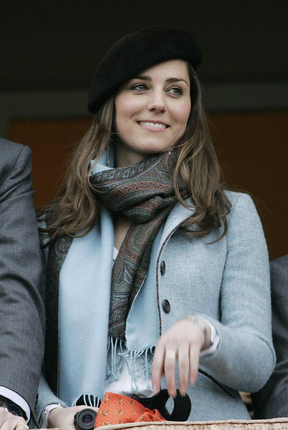 <p>At the final day of Cheltenham Festival in Gloucestershire, England wearing a black beret and paisley scarf.</p>