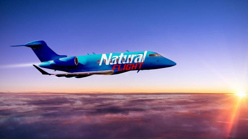 A Natural Light branded jet flying in the sky