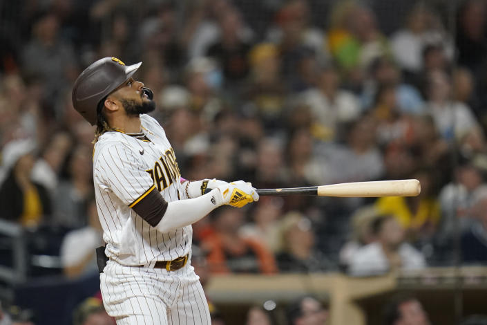 San Diego Padres' Fernando Tatis Jr. watches his home run ball during the seventh inning of a baseball game against the San Francisco Giants, Wednesday, Sept. 22, 2021, in San Diego. (AP Photo/Gregory Bull)