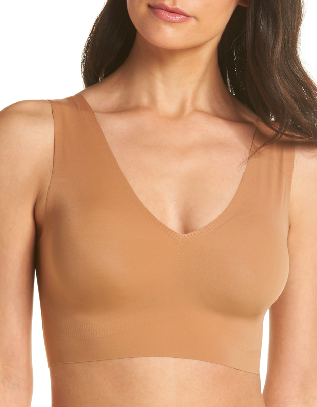 """This one's a winner for support without bulk, and its light, barely-there feel is perfect for high summer's hottest days. It comes in five different chic neutrals, one for every <a href=""""https://www.glamour.com/gallery/the-exact-bra-to-wear-under-every-tricky-summer-top-and-dress?mbid=synd_yahoo_rss"""" rel=""""nofollow noopener"""" target=""""_blank"""" data-ylk=""""slk:tricky"""" class=""""link rapid-noclick-resp"""">tricky</a> late-summer look. $49, Nordstrom. <a href=""""https://www.nordstrom.com/s/true-co-true-body-v-neck-bralette/4860917"""" rel=""""nofollow noopener"""" target=""""_blank"""" data-ylk=""""slk:Get it now!"""" class=""""link rapid-noclick-resp"""">Get it now!</a>"""