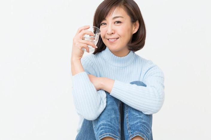 Asian middle age woman who drinks water
