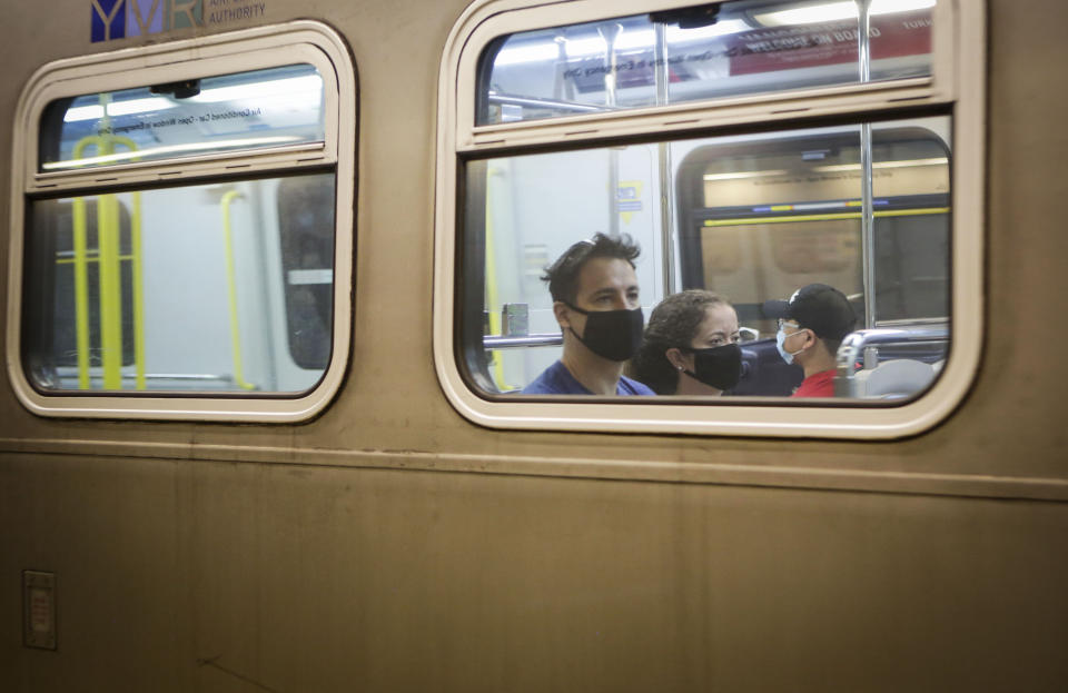 VANCOUVER, July 18, 2020 -- Passengers wearing face masks ride a SkyTrain in Vancouver, British Columbia, Canada, on July 18, 2020. As new COVID-19 cases in British Columbia continued to tick upwards, health officials urged those who can to wear a mask on transit and in other confined spaces, such as grocery stores. (Photo by Liang Sen/Xinhua via Getty) (Xinhua/Liang Sen via Getty Images)