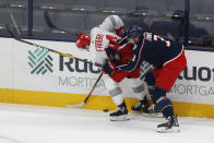 Detroit Red Wings' Robby Fabbri, left, and Columbus Blue Jackets' Seth Jones fight for a loose puck during the first period of an NHL hockey game Tuesday, March 2, 2021, in Columbus, Ohio. (AP Photo/Jay LaPrete)