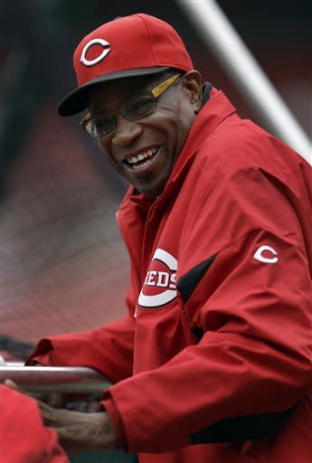 Cincinnati Reds manager Dusty Baker smiles as he watches batting practice before a baseball game against the St. Louis Cardinals, Monday, Oct. 1, 2012, in St. Louis. Baker is back with his team after missing 11 games because of a mini-stroke, and will manage the team during the final series of the regular season. (AP Photo/Jeff Roberson)